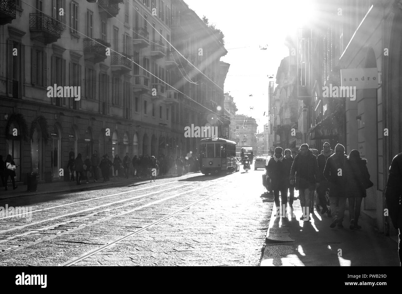 Milan, Italy - 30 Dec, 2017 - People walking down the street in Milan - Stock Image