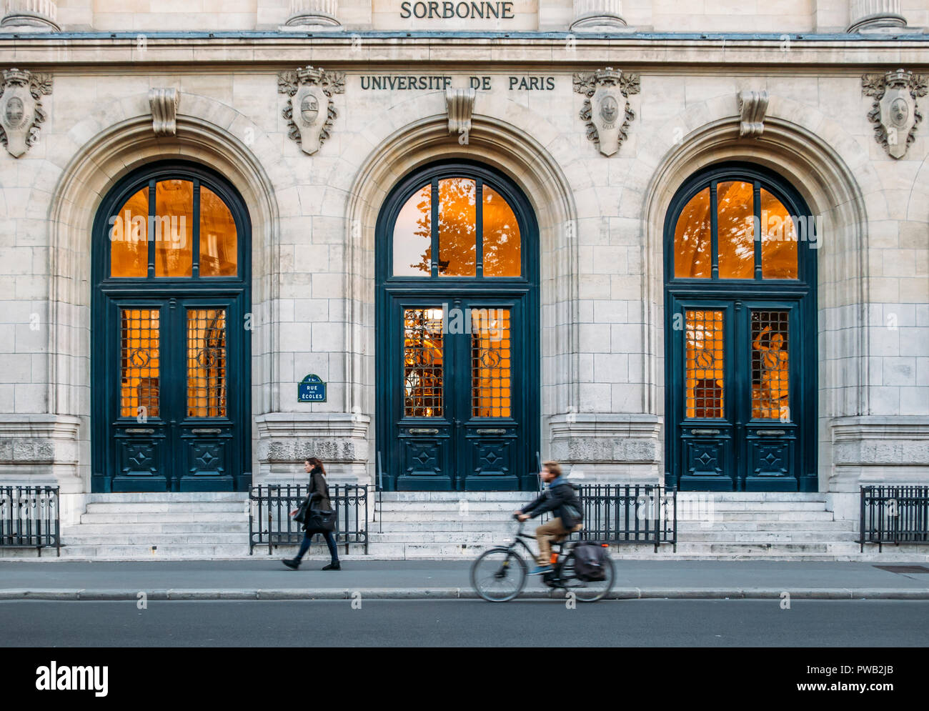 Paris, France - Oct 13, 2018: Pedestrian and cyclist with outside facade of the prestigious University Sorbonne in Paris, France - Stock Image