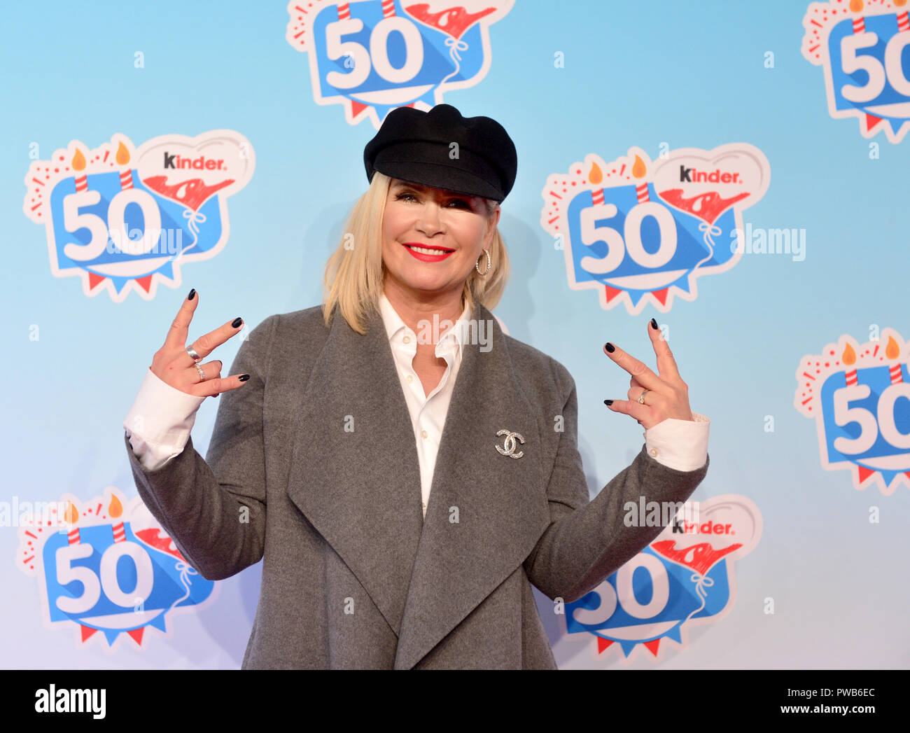 Soltau, Lower Saxony. 14th Oct, 2018. 14 October 2018, Germany, Soltau: Model and designer Claudia Effenberg comes to an event of the company Kinder Schokolade in the Heide-Park. The Kinder brand celebrates its 50th anniversary with a family celebration in the park. Credit: Hauke-Christian Dittrich/dpa/Alamy Live News - Stock Image