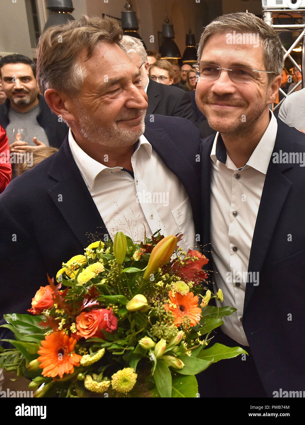 Potsdam, Brandenburg. 14th Oct, 2018. 14 October 2018, Germany, Potsdam: Jann Jakobs (SPD), Lord Mayor of Potsdam, congratulates Mike Schubert (SPD) on his victory at the election party. Schubert was elected new Lord Mayor with 55.3 percent of the votes. Credit: Bernd Settnik/dpa-Zen tralbild/dpa/Alamy Live News - Stock Image