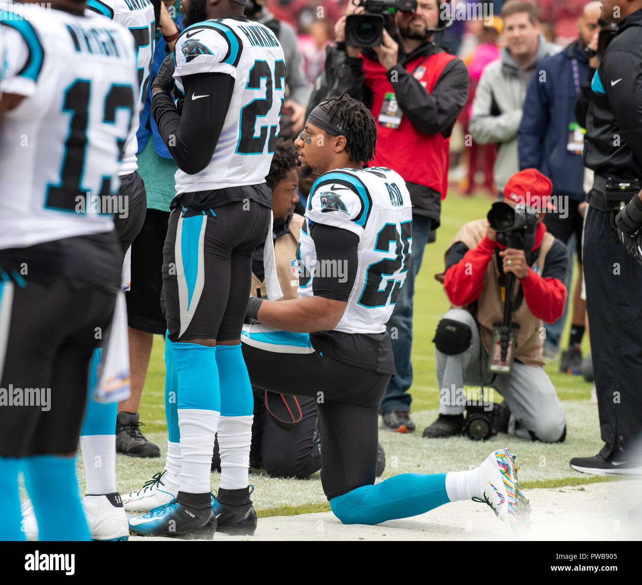Carolina Panthers strong safety Eric Reid (25) kneels as the National Anthem  is played prior to the game against the Washington Redskins at FedEx Field  in ... 4d322b3d7