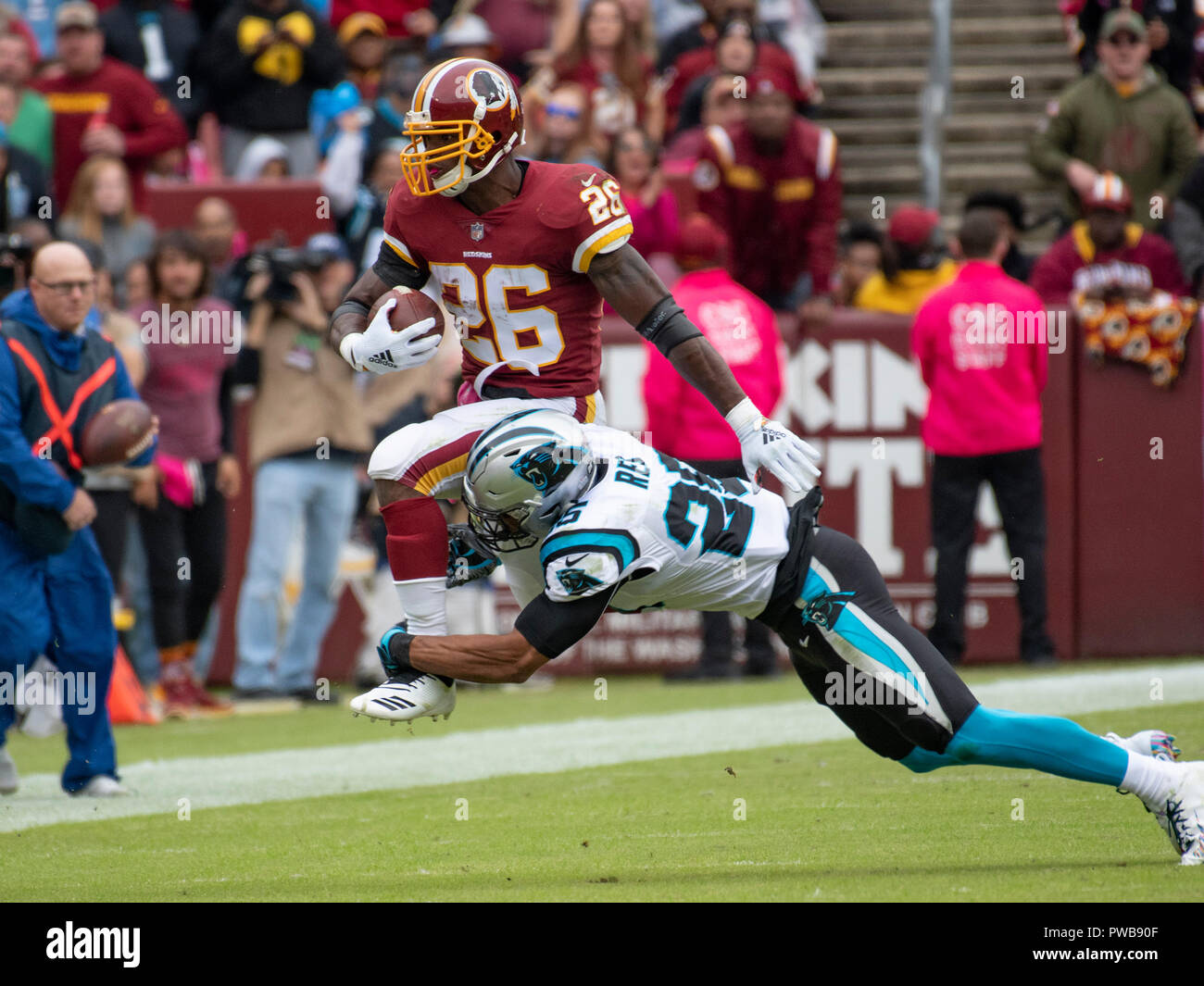 da0a9f3cb78 Washington Redskins running back Adrian Peterson (26) is tackled by Carolina  Panthers strong safety