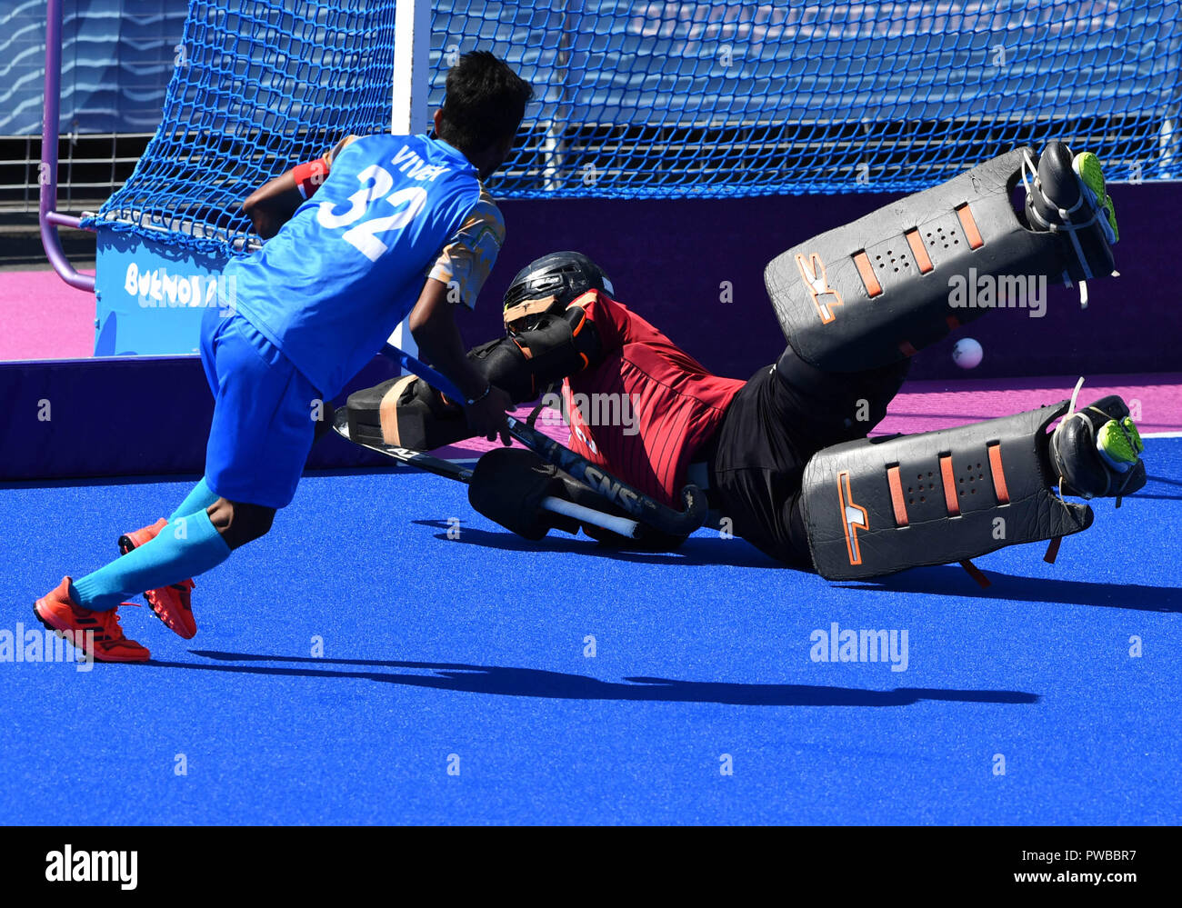 Buenos Aires, Argentina. 14th Oct, 2018. Vivek Sagar Prasad (L) of India shoots during the men's hockey5s final between Malaysia and India at the 2018 Summer Youth Olympic Games in Buenos Aires, Argentina, on Oct. 14, 2018. Malaysia won 4-2 to claim the title. Credit: He Changshan/Xinhua/Alamy Live News - Stock Image