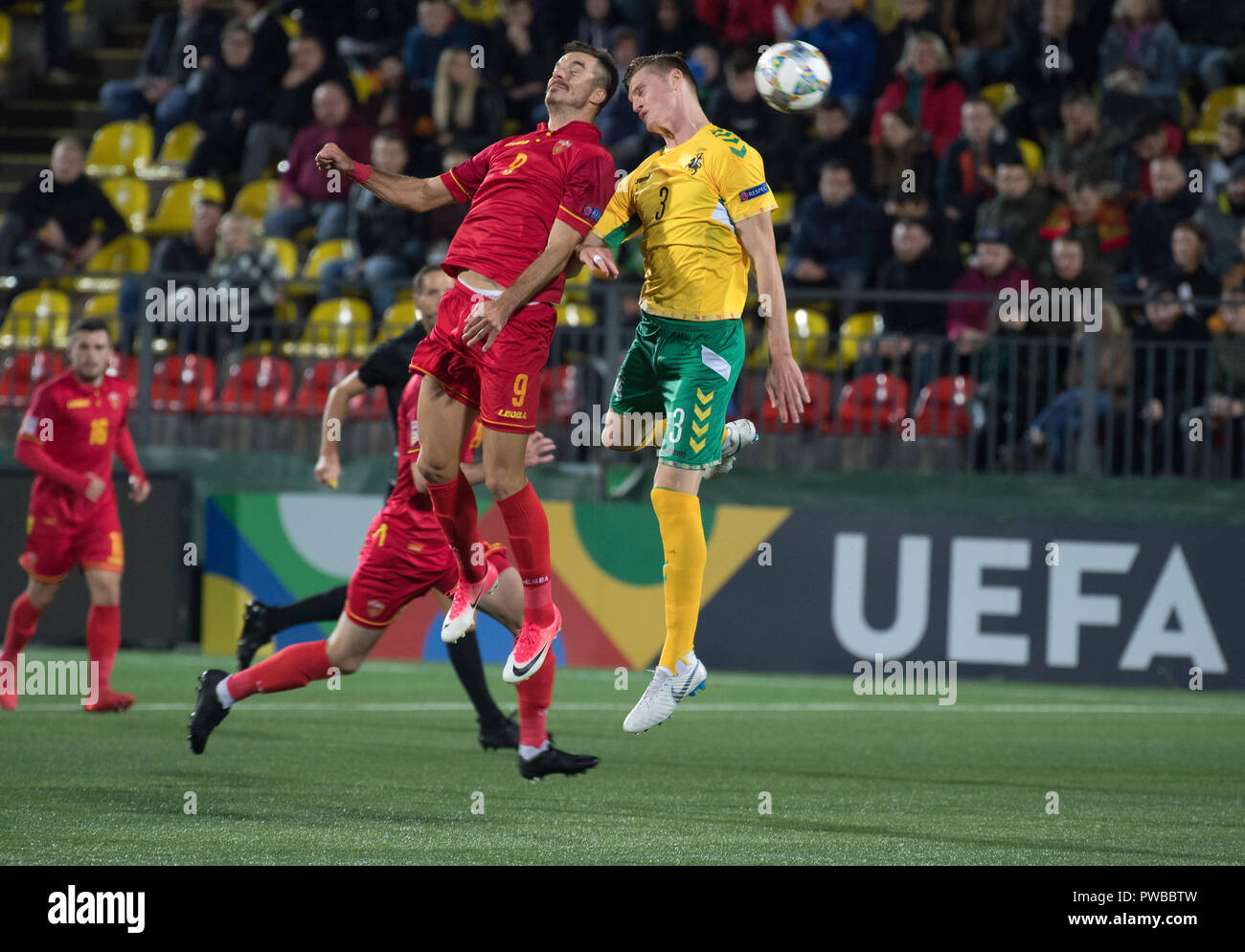 Vilnius, Lithuania. 14th Oct, 2018. Stefan Mugosa (L) of Montenegro vies with Justinas Janusevskis of Lithuania during the UEFA Nations League C match at LFF Stadium in Vilnius, Lithuania, on Oct. 14, 2018. Montenegro won 4-1. Credit: Alfredas Pliadis/Xinhua/Alamy Live News - Stock Image