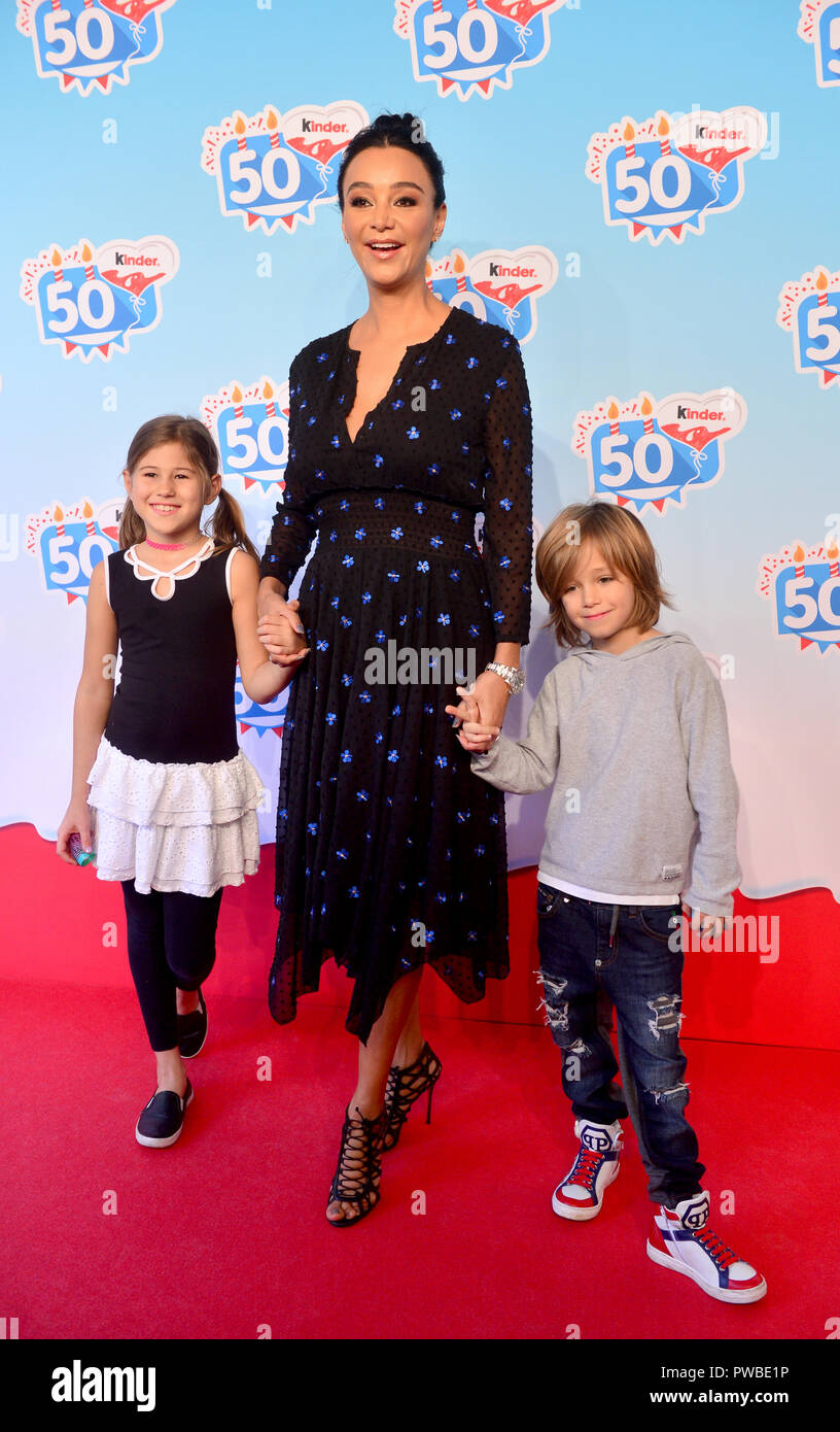 Soltau, Lower Saxony. 14th Oct, 2018. Presenter Verona Pooth comes with her son Rocco (r) and Minou (l), the daughter of her best friend, to an event of the company Kinder Schokolade in the Heide-Park. The Kinder brand celebrates its 50th anniversary with a family celebration in the park. Credit: Hauke-Christian Dittrich/dpa/Alamy Live News Stock Photo