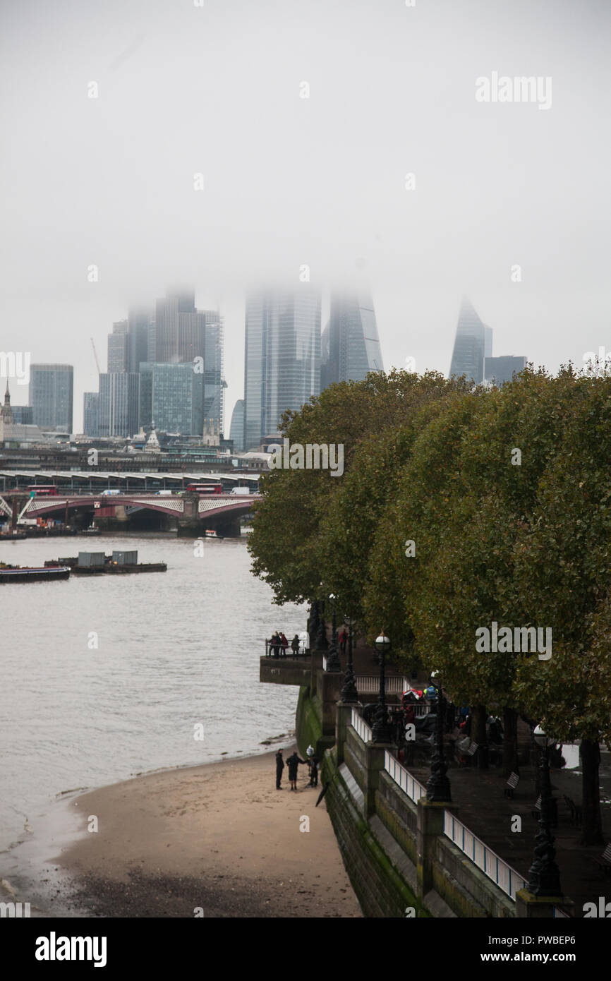 London, UK. 15th Oct, 2018. London Skyline and financial district covered in morning fog on a gloomy overcast autumn day Credit: amer ghazzal/Alamy Live News Stock Photo