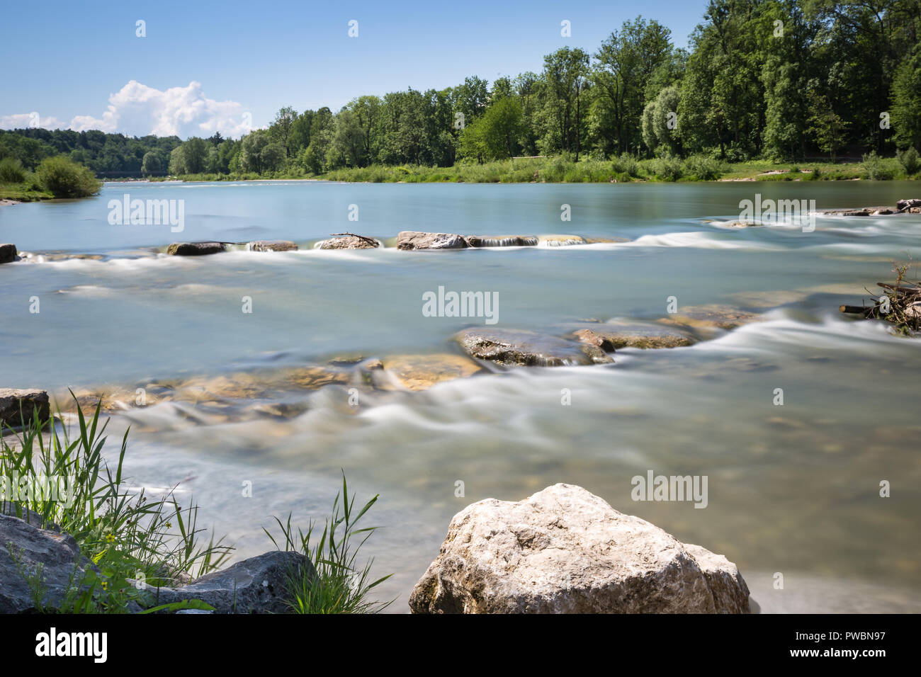 Longtime Exposure of River with River Steps and River Bank in Munich, Bavaria, Germany, Europe - Stock Image