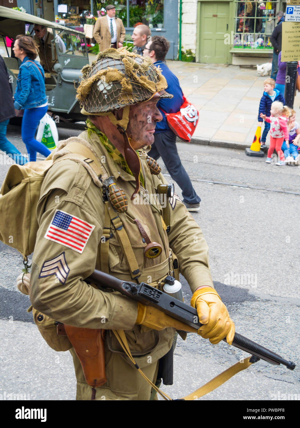 October 2018 a man dressed as an American GI infantryman with gun and grenades in World War two at an annual re-enactment in Pckering North Yorkshire - Stock Image