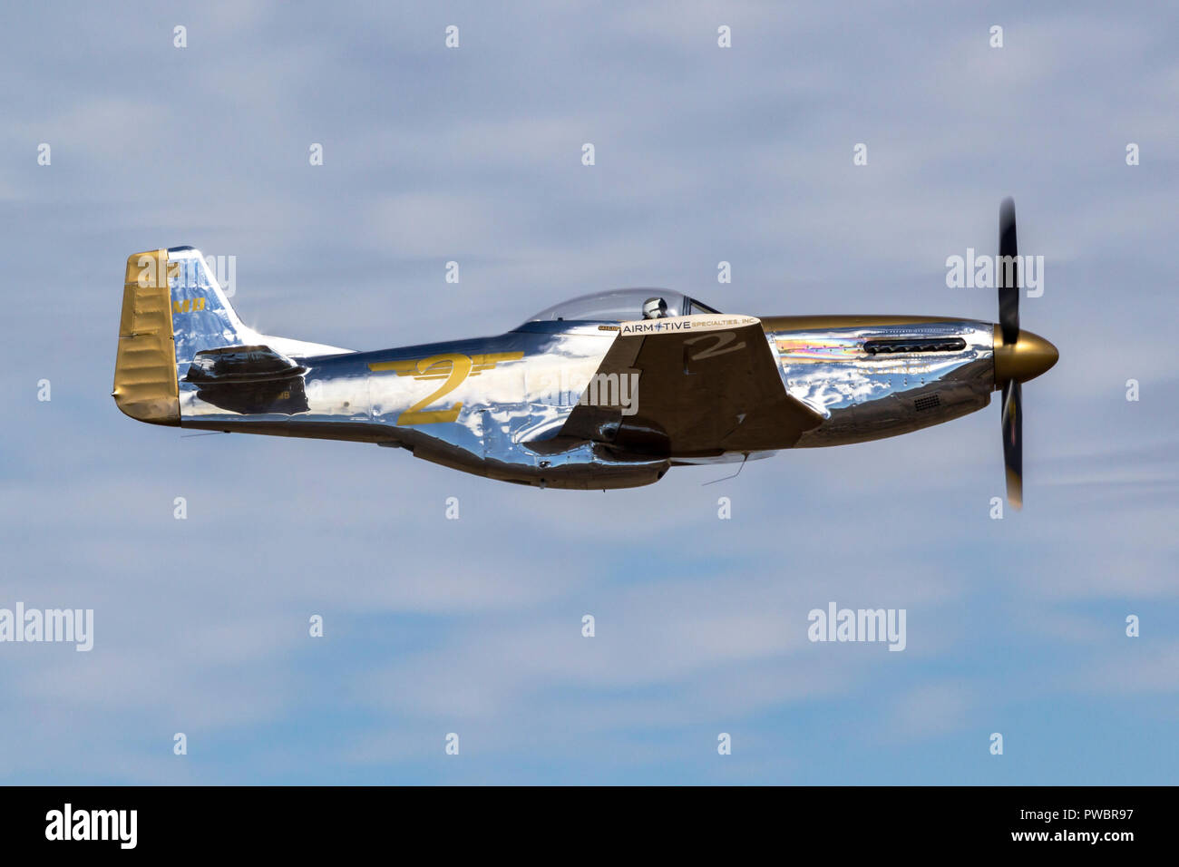 Mike Brown pilots his modified P-51 Mustang during the Reno National Championship Air Races. - Stock Image