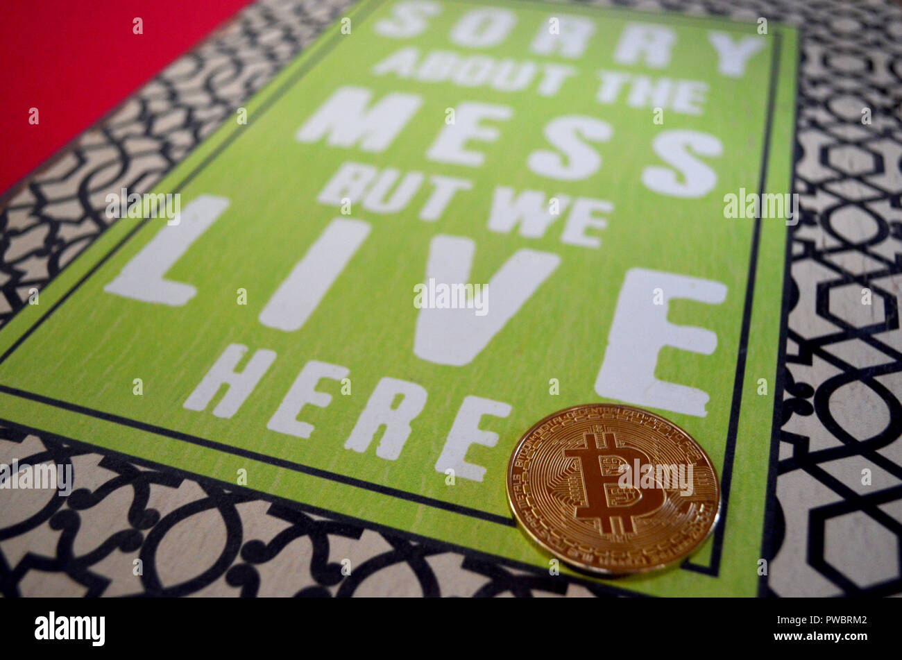 Bitcoin with sorry about mess sign Stock Photo