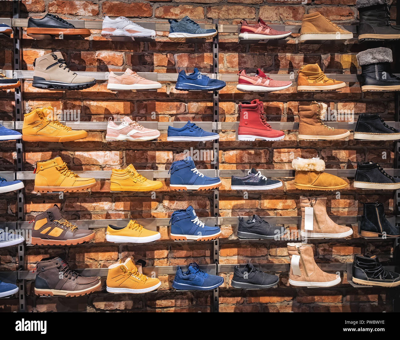Shoes in the shop window. Lots of different men s and women s shoes sneakers 24a953ed8