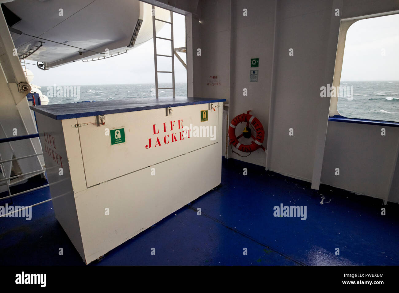 life jacket at muster station of stena line ferry making rough irish sea crossing during storm - Stock Image