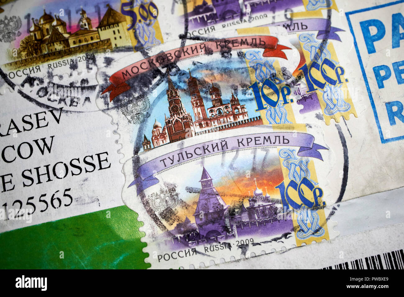 russian postmarked mail and stamps posted in moscow - Stock Image