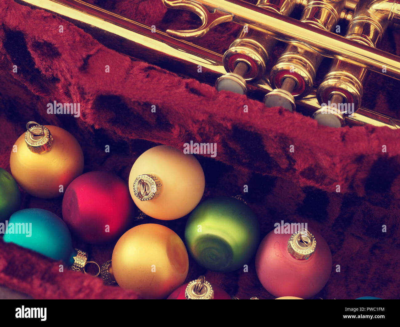 Colorful vintage Christmas baulbes with an old used trumpet ...
