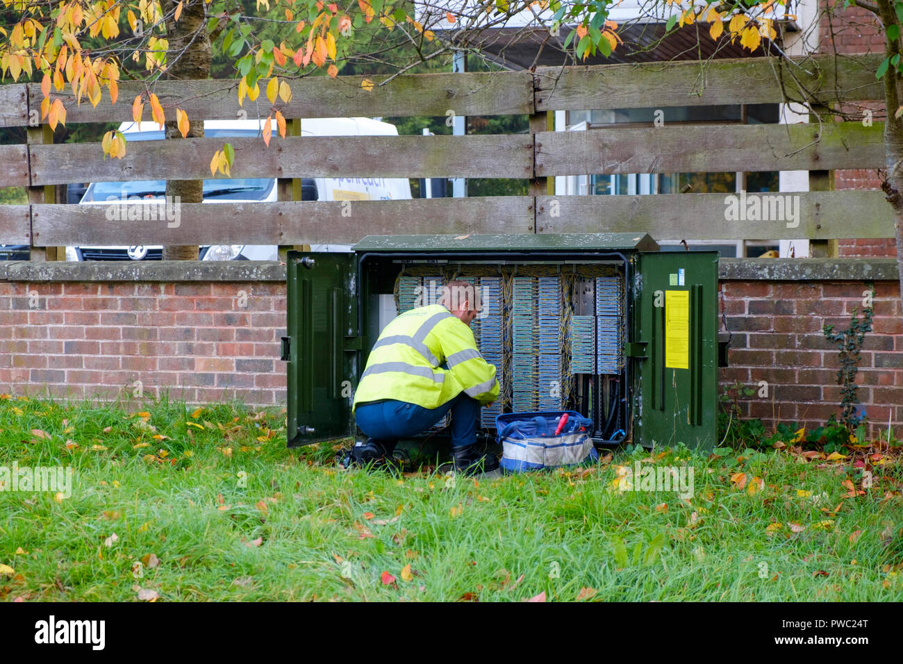 Bt Engineer Box Stock Photos Images Alamy Wiring Openreach Telephone Kneeling In Front Of A Cabinet Kent Uk