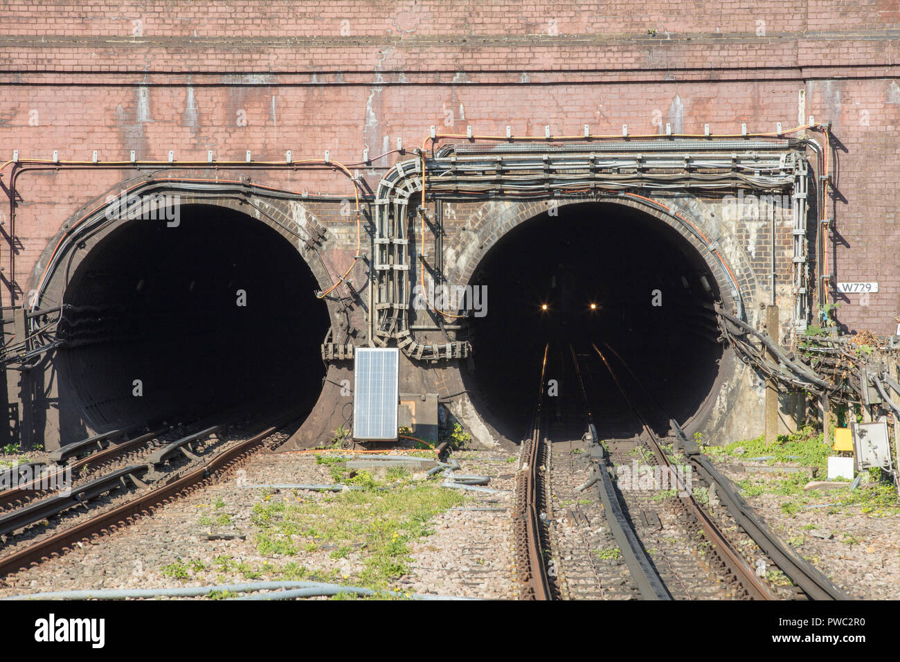 London underground tube train emerging from a tunnel on the northern line station Hendon, in the north west, towards the centre and south of the city. - Stock Image
