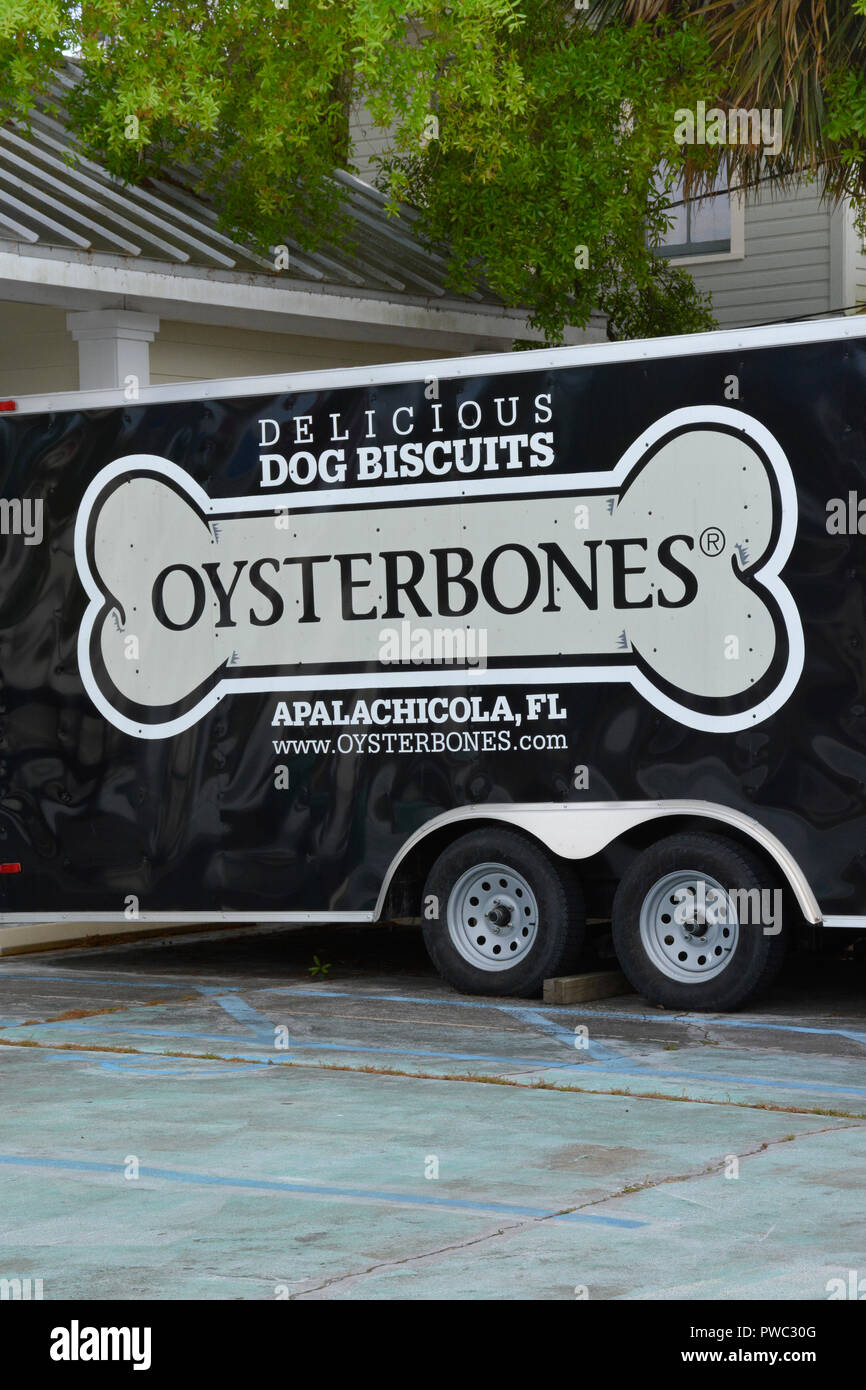 Close up of The Oysterbones Pet store trailer in Apalachicola, FL, with trendy advertising on their trailer parked outside - Stock Image