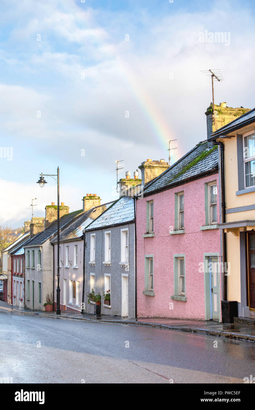 A rainbow over traditional houses along Main Street in Cong, on the border of County Galway and County Mayo in Ireland. Stock Photo