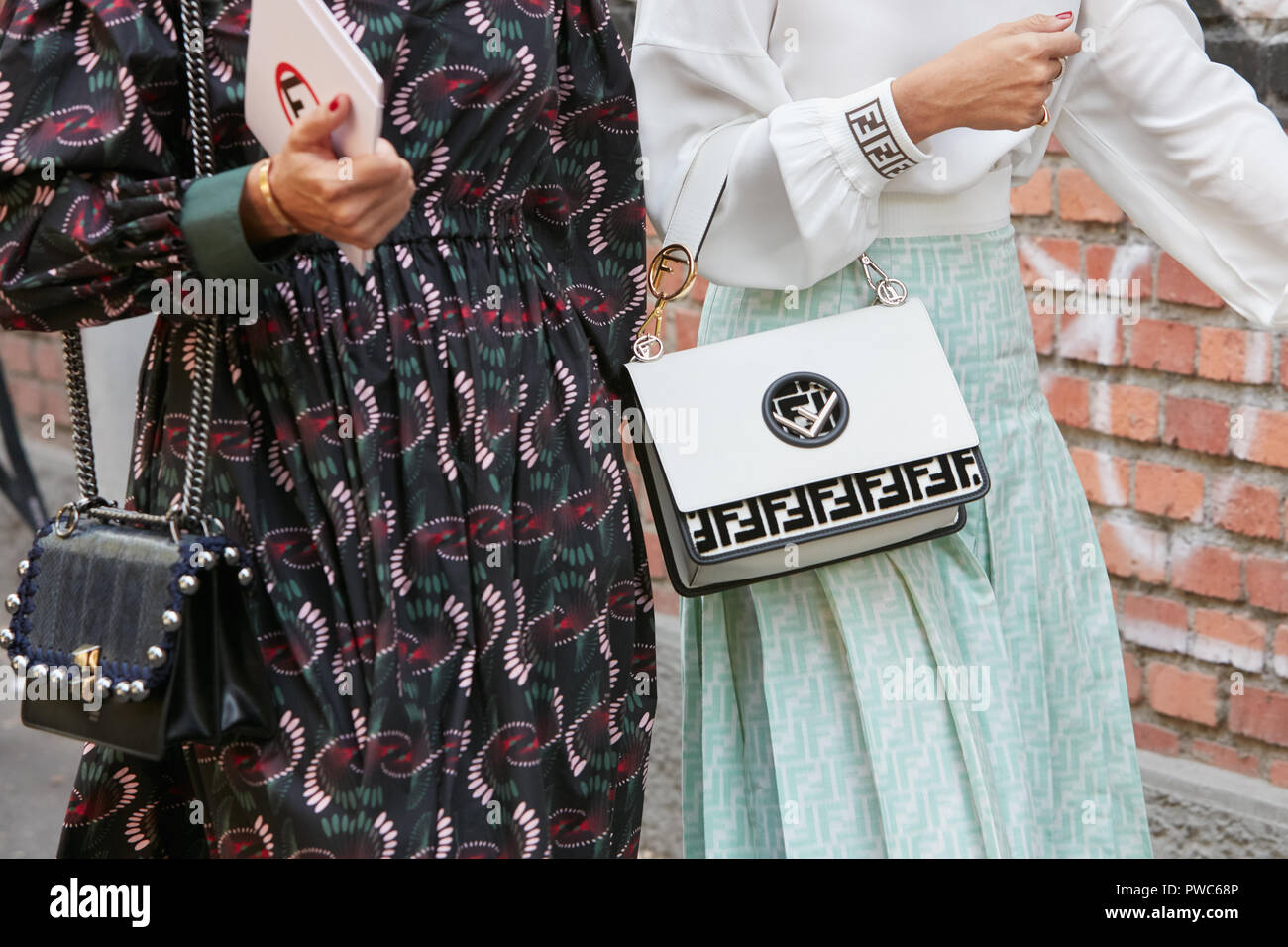 7514944f7d MILAN, ITALY - SEPTEMBER 20, 2018: Women with black and white Fendi ...