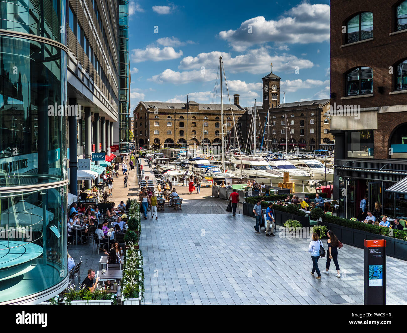 St. Katharine Docks Marina, an historic dock near Tower bridge and the Tower of London, now converted to a marina with offices, restaurants and bars. - Stock Image