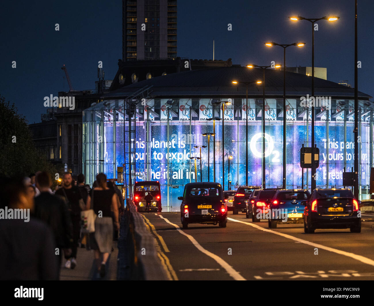 BFI IMAX cinema on London SouthBank across Waterloo Bridge, designed by Avery Associates Architects completed in May 1999. Operated by Odeon Cinemas. - Stock Image