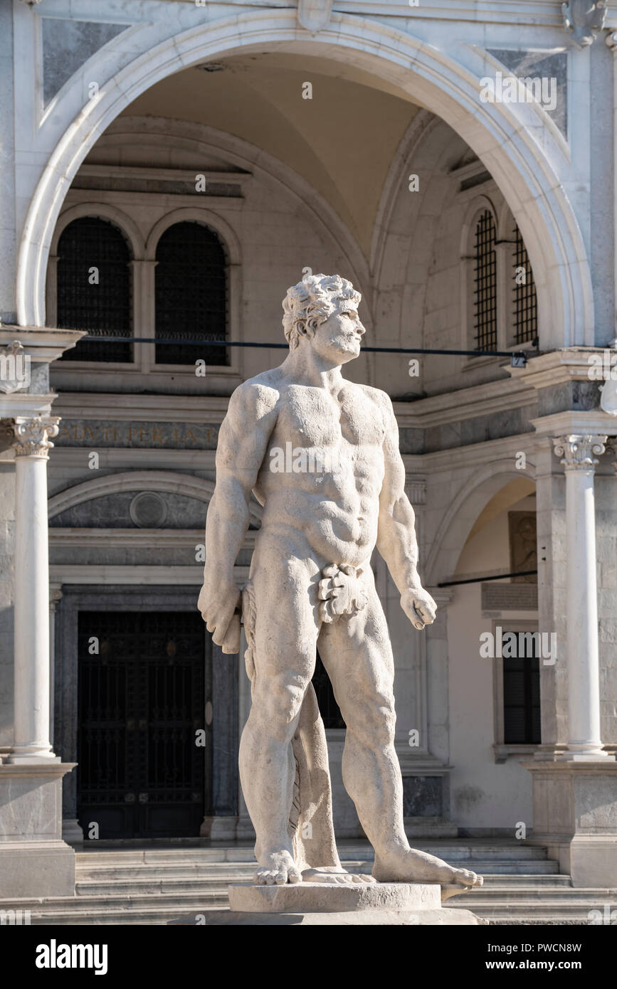 The statue of Hercules made by the sculptor Angelo de Putti in Freedom Square in Udine, Italy - Stock Image
