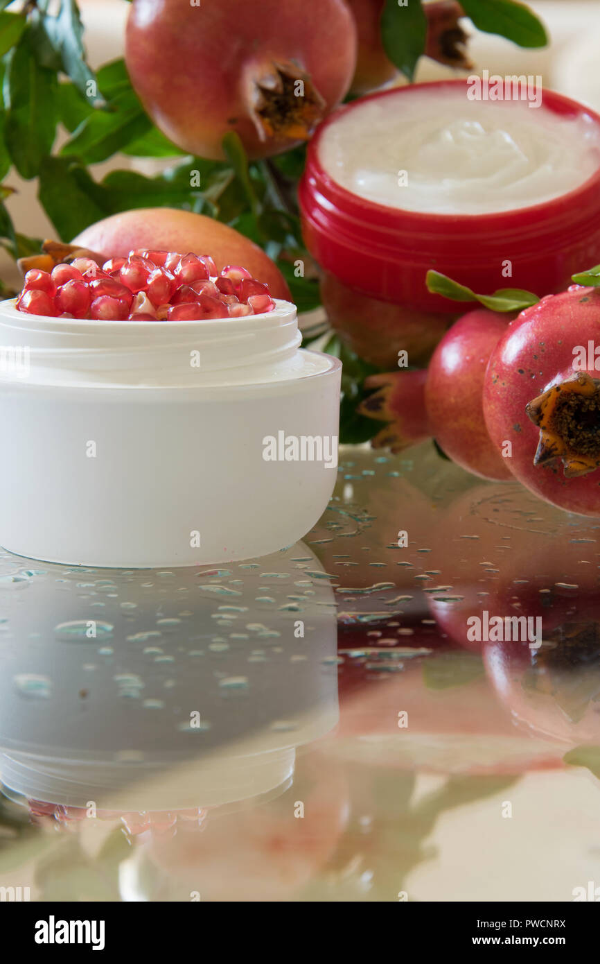 Pomegranate Anti-aging face cream, beauty cosmetics industry - Stock Image