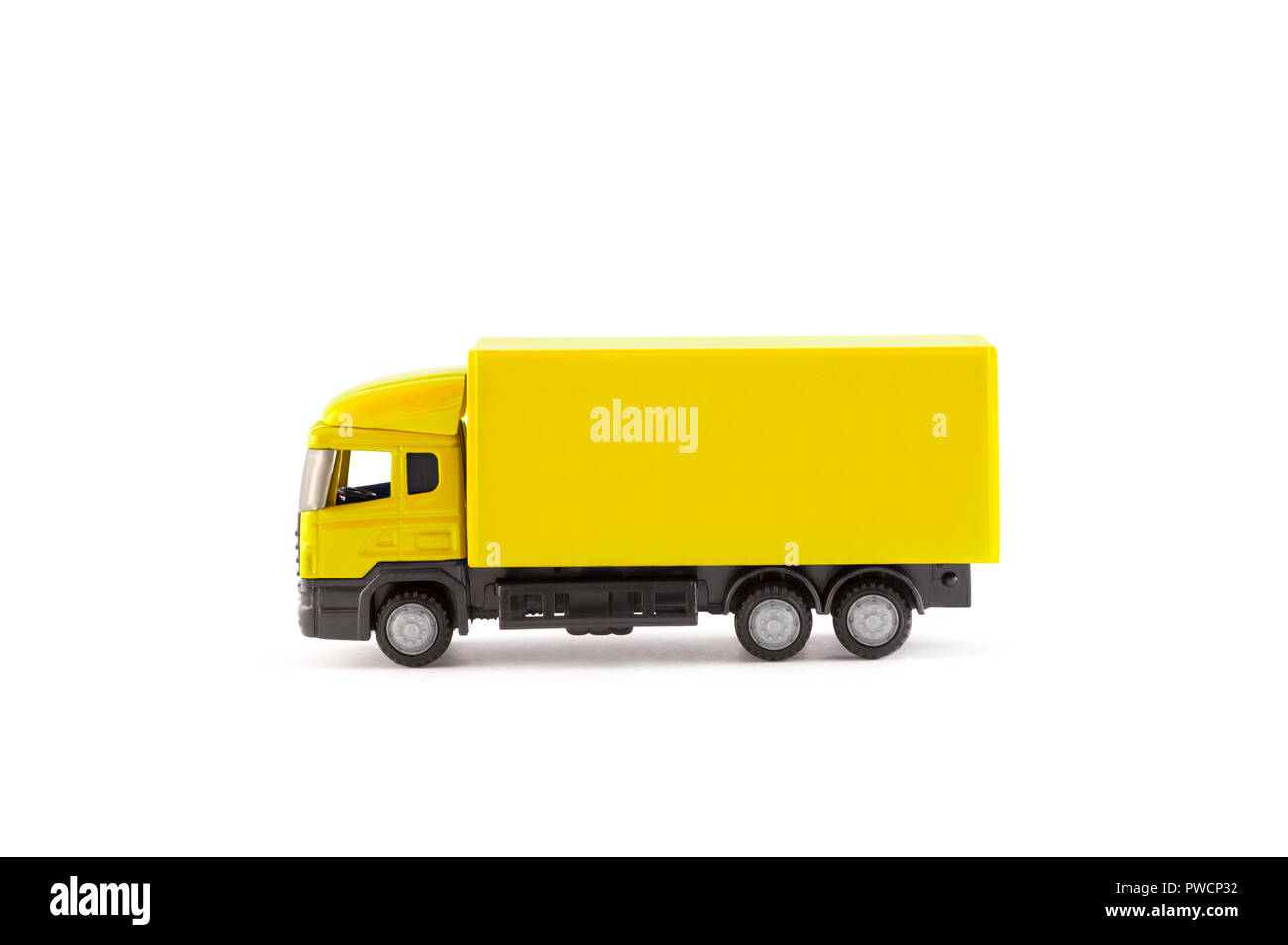 Yellow truck miniature on white background - Stock Image