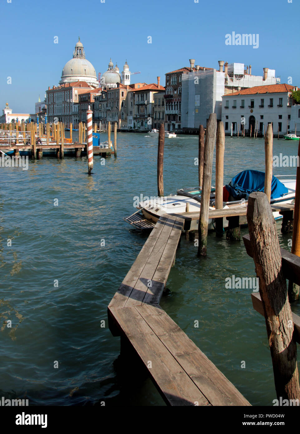Walking about Venice can be tricky when faced with just a few planks of wood to walk on in most places. - Stock Image