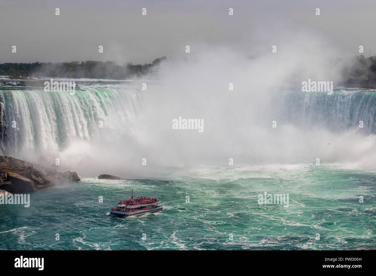 A boat at the Niagara Falls - Stock Image