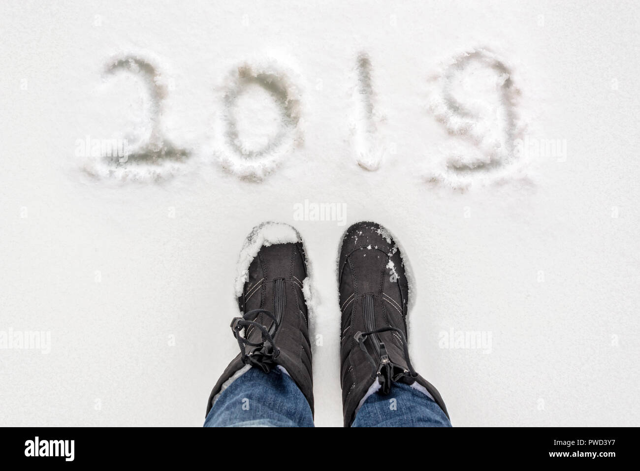 Selfie of boots and 2019 written in the snow, winter concept - Stock Image