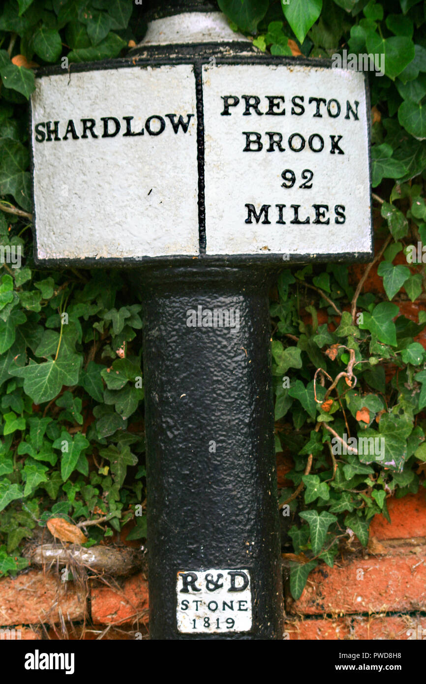 Milestone distance marker at the start of the Trent and Mersey canal at Shardlow Derbyshire England UK showing Preston Brook 92 miles - Stock Image