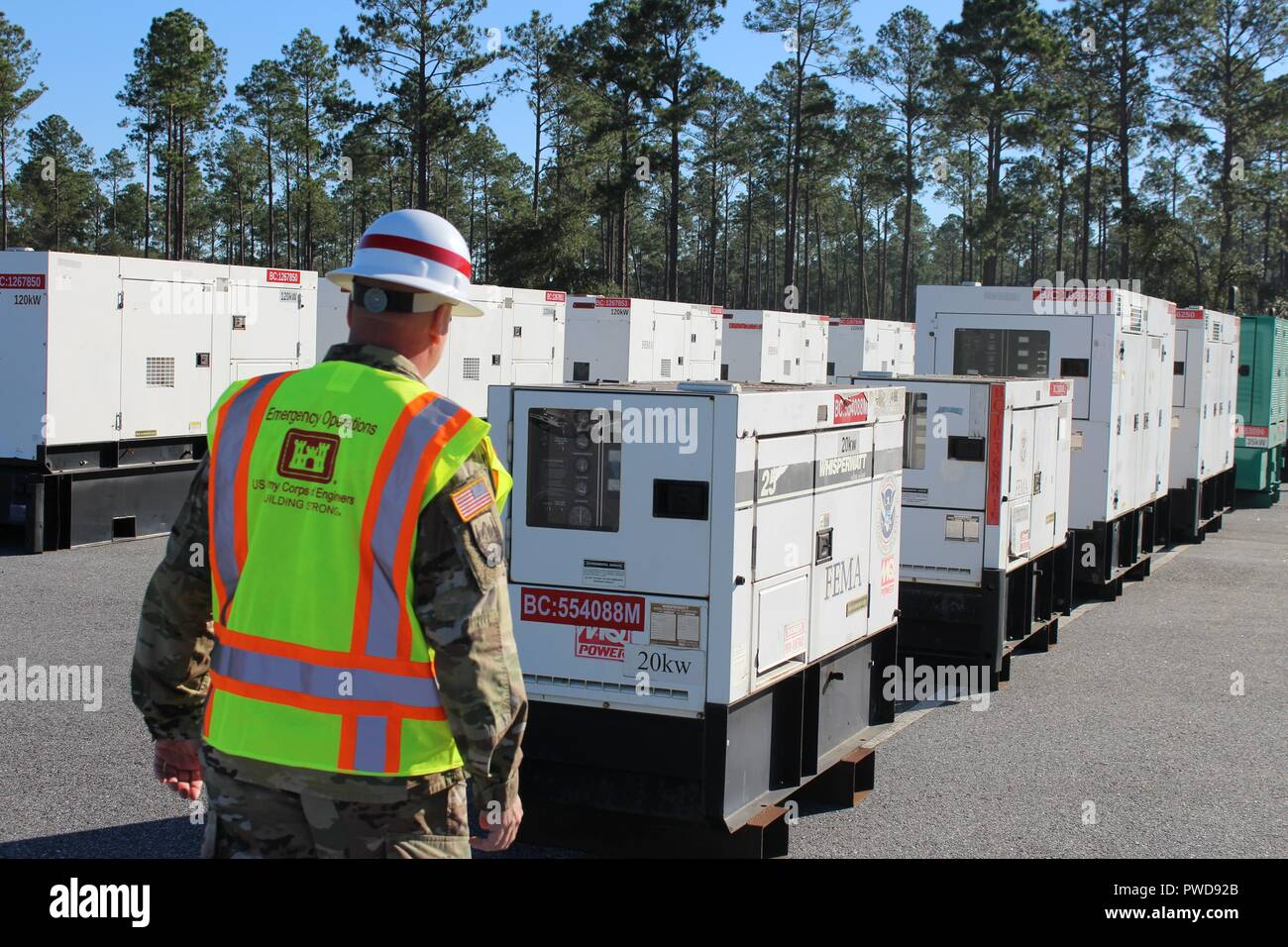 USACE has received 7 FEMA Mission Assignments (7 active, 6 closed), totaling more than $10.5 million for disaster response to Hurricane Michael-damaged areas, October 13, 2018. One of those missions is to provide Temporary Emergency Power. The USACE Temporary Power PRT and the 249th Engineer Battalion are deployed and assessing sites for installation of emergency generators. Sergeant First Class Robert Fox, 249th Engineer Battalion, C Company out of Fort Belvoir, Virginia, inspects a generator upon delivery to the Incident Support Base in Albany, Ga. (U.S. Army photo by Chris Gardner). () - Stock Image