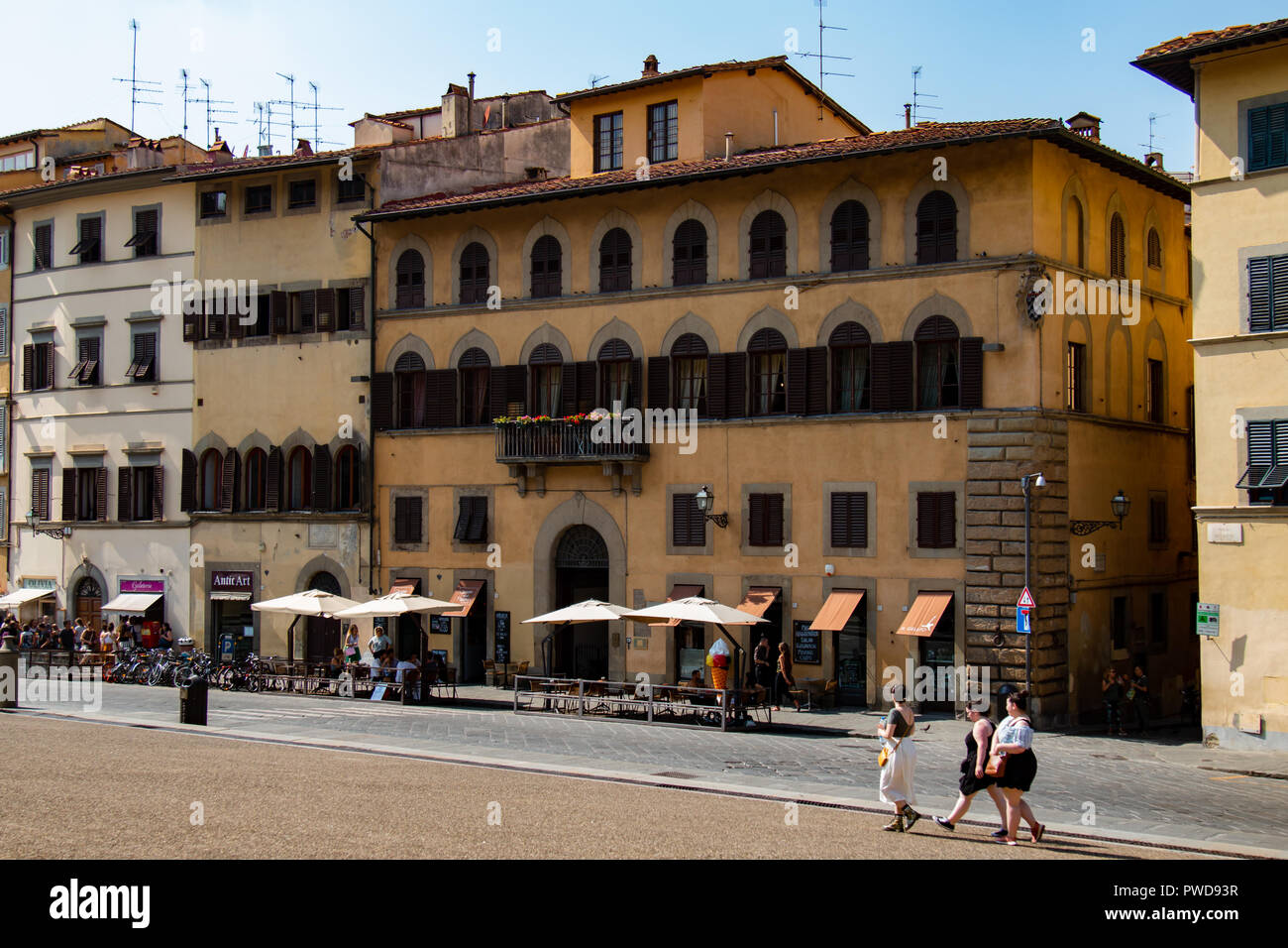 Timeworn buildings line the road opposite the Pitti Palace in Florence, Italy. - Stock Image