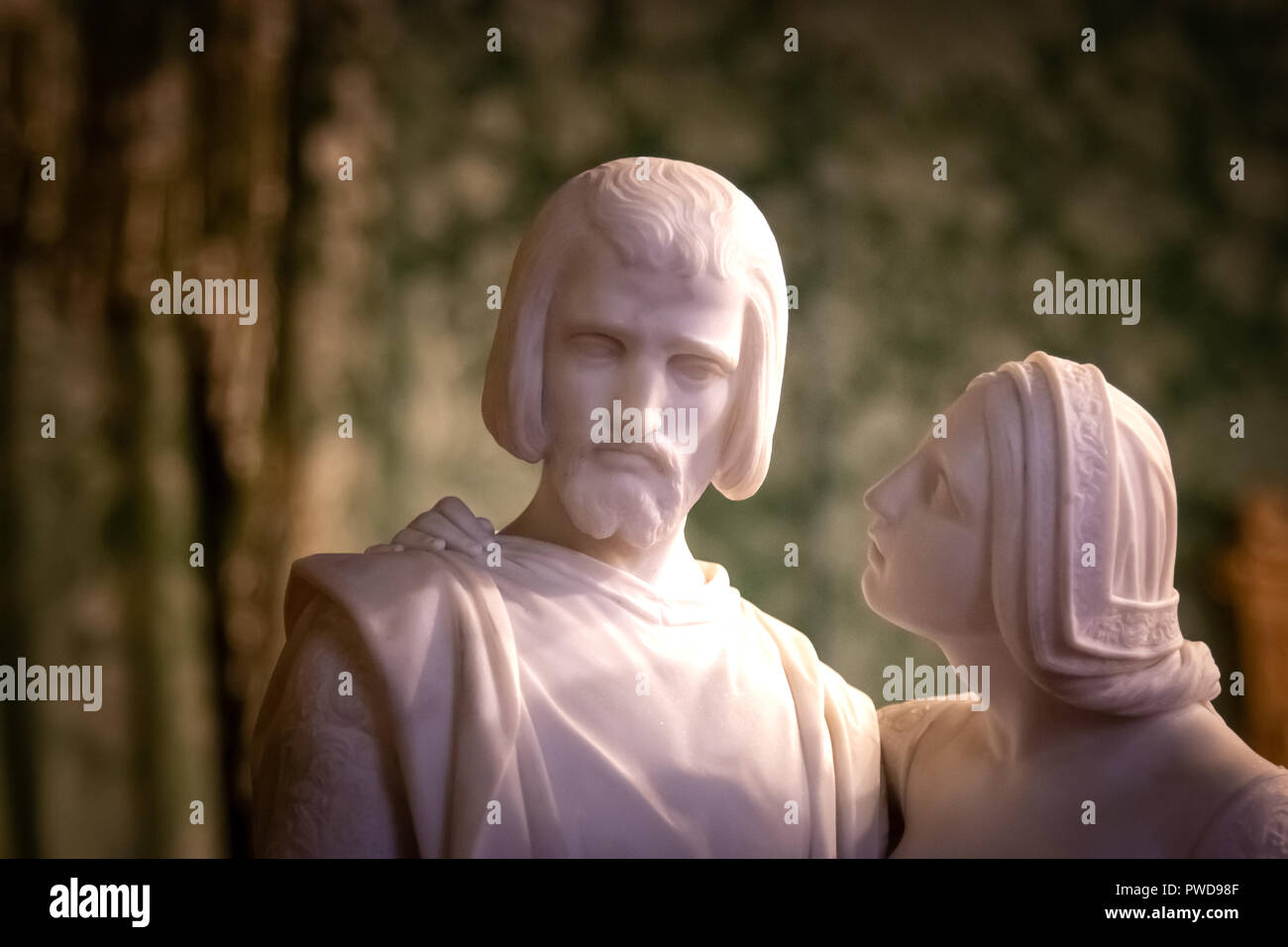 A woman looks with concern at a man in this statue on display in the Pitti Palace in Florence, Italy. - Stock Image