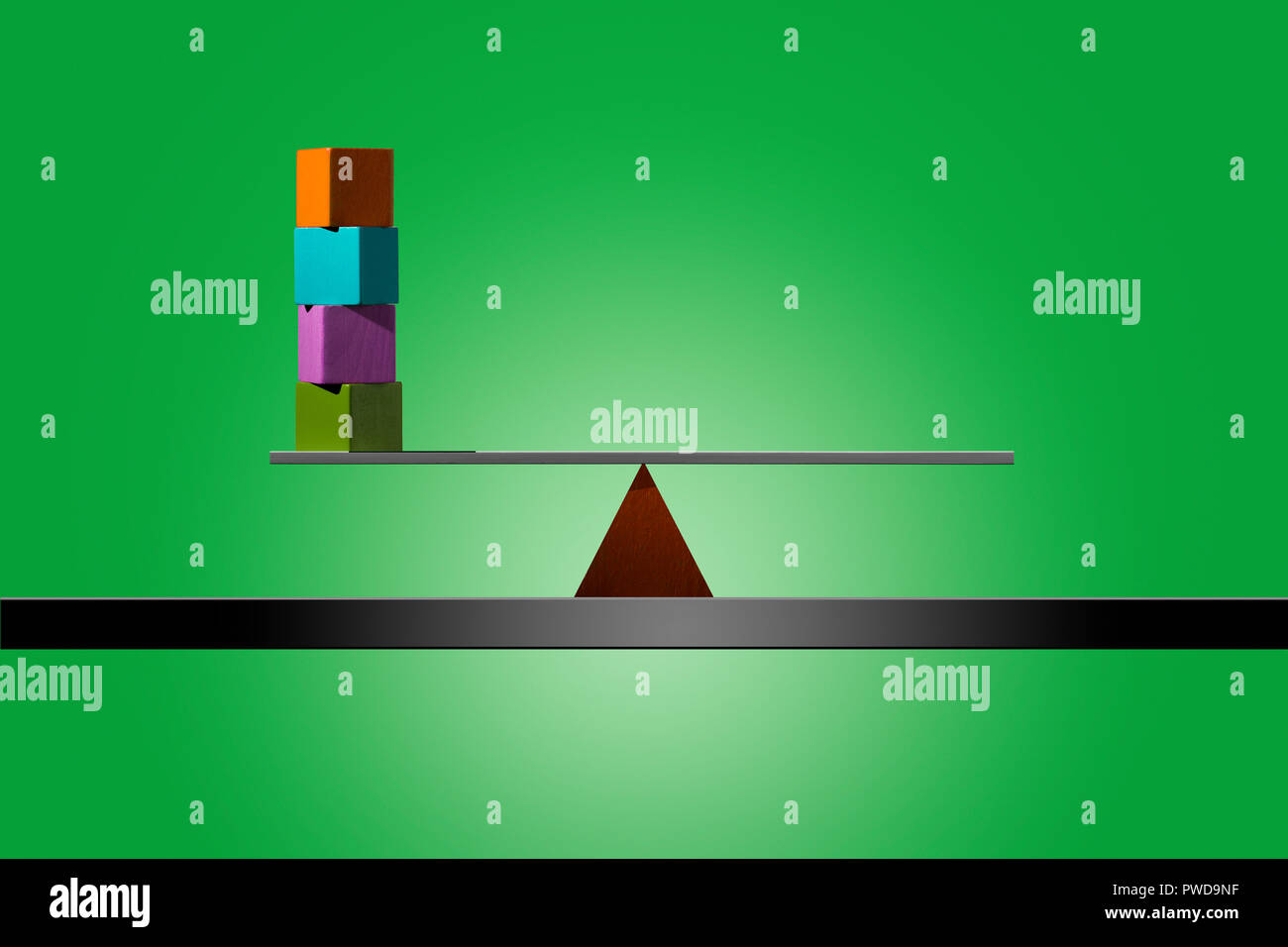Concept 4 Four Color Cubes Stacked in Balance on Strip of Wood, Equilibrium - Stock Image