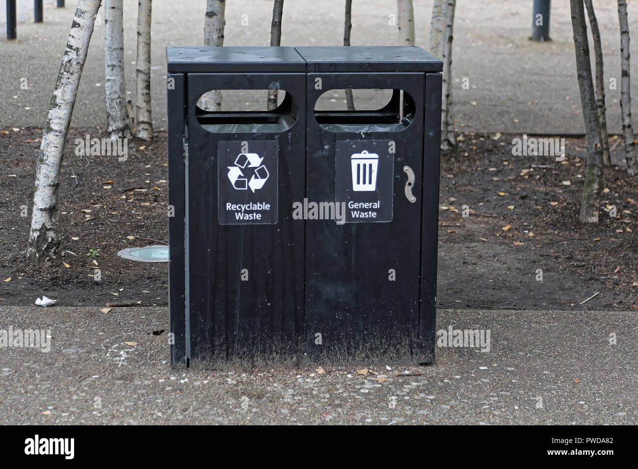 Public Black Trash Can for General Waste and Recycling - Stock Image