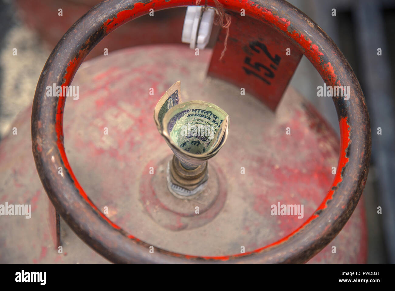 Price hike for LPG gas cylinder effects poor villagers so Indian government providing gas subsidy to poor people - Stock Image