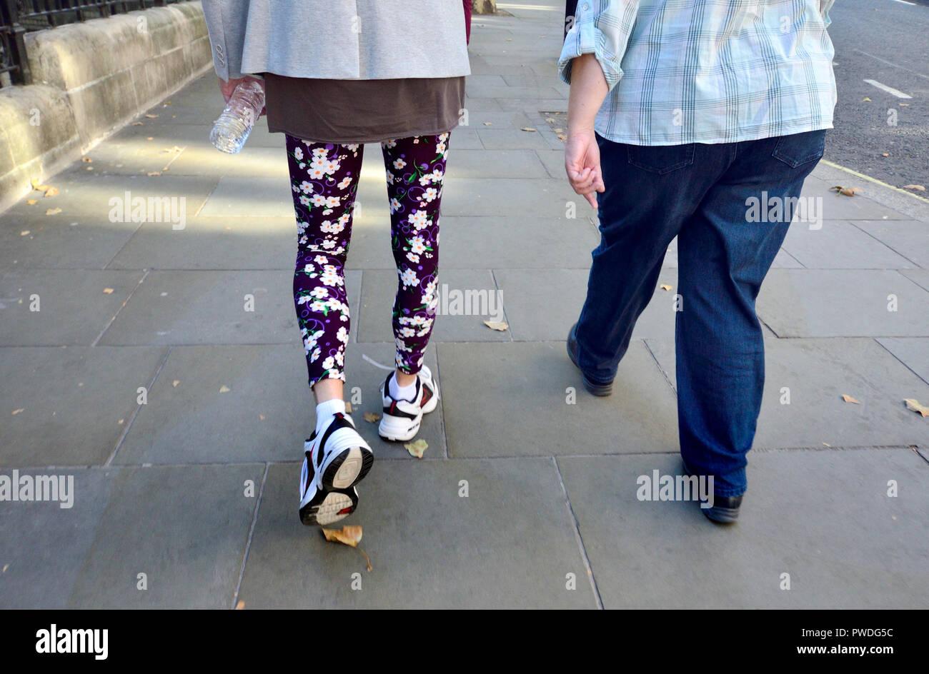 Man wearing flowery leggings, London, England, UK. - Stock Image