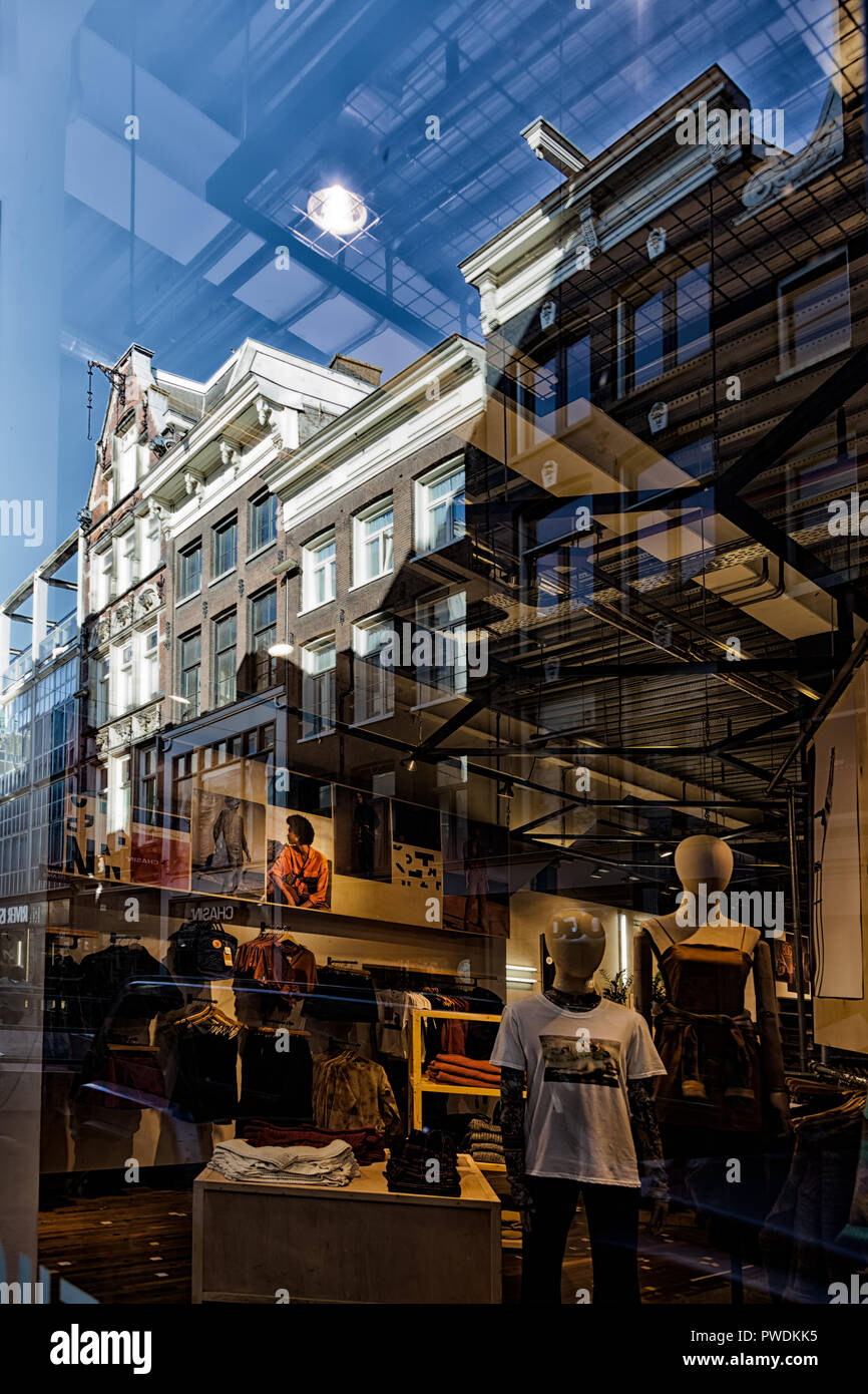 Shop front and reflected buildings in Amsterdam, Netherlands - Stock Image