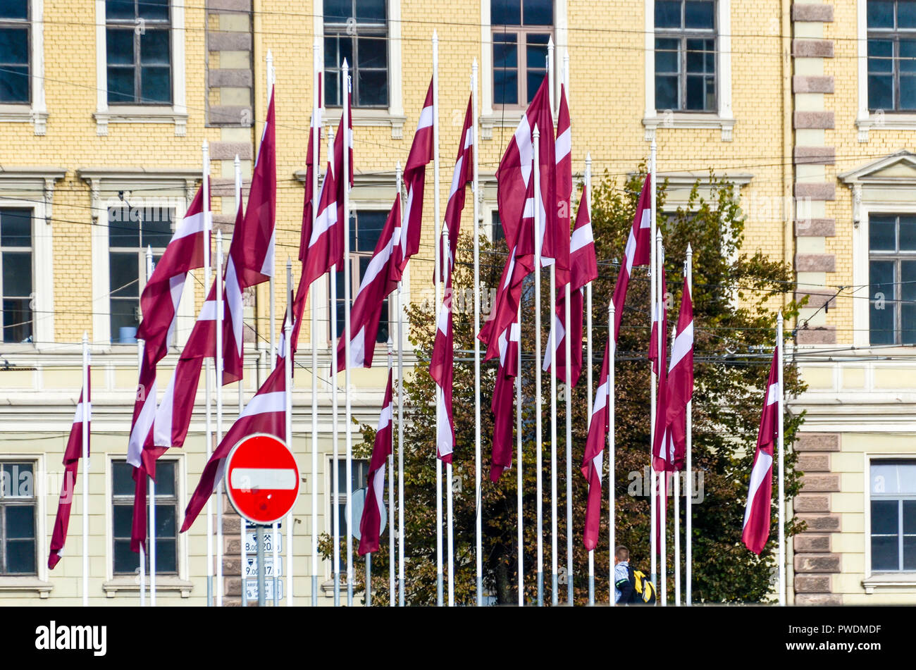 Latvian flags and Prohibitory traffic sign in Riga, Latvia - Stock Image