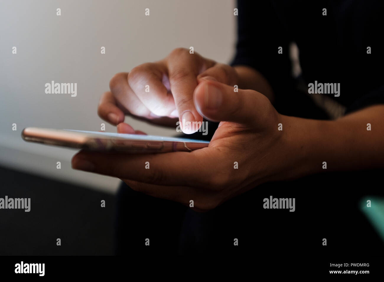 Selective focus,close-up of  woman using a touch screen smart phone - Stock Image