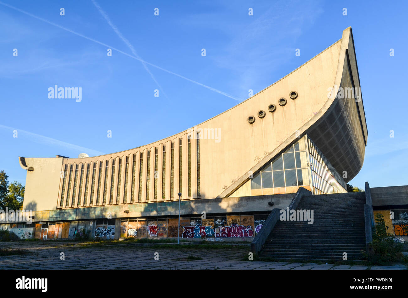 Vilnius Palace of Concerts and Sports, a large disused building by the Neris river - Stock Image