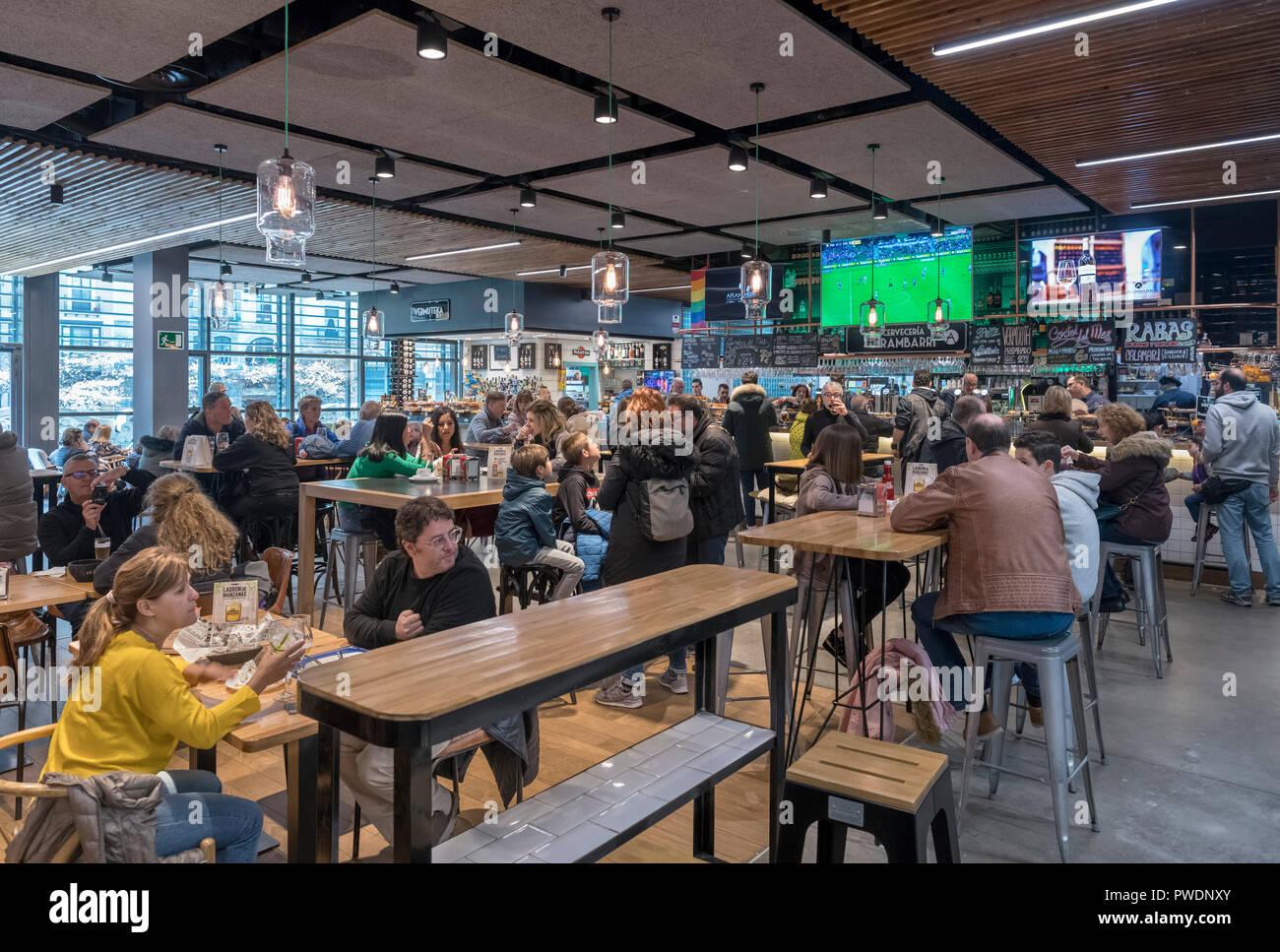 Bars and cafes in the Mercade de la Ribera, Casco Viejo, Bilbao, Basque Country, Spain - Stock Image