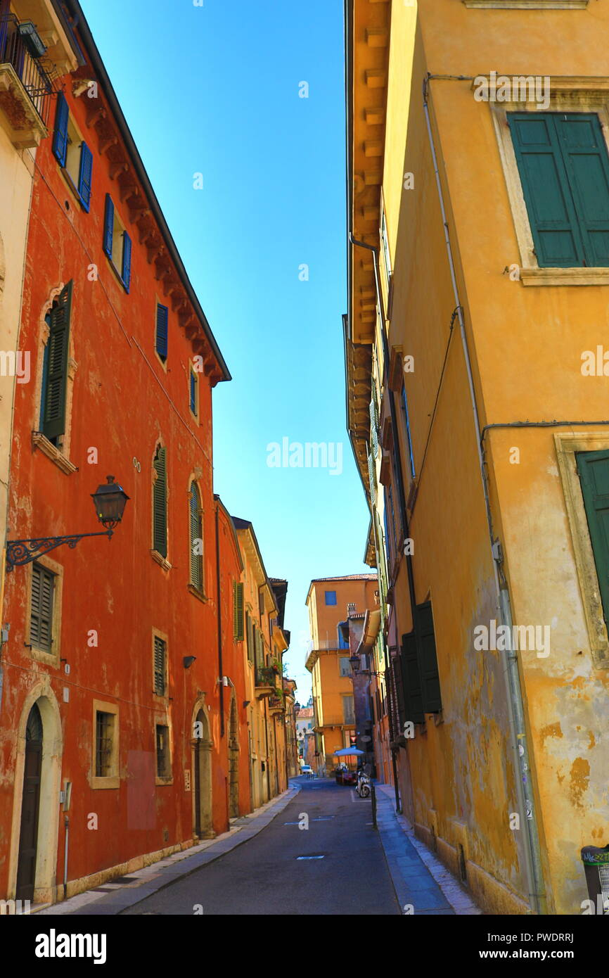 Nice street lined with colorful painted  buildings from the Old town of Verona,Italy,July 18th 2018 - Stock Image