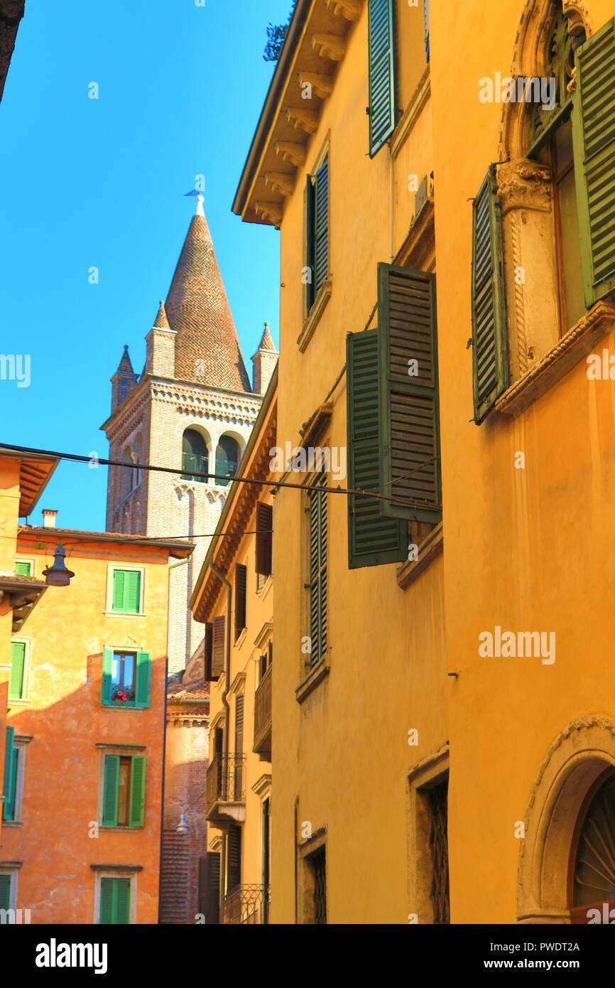 Nice street lined with colorful painted  buildings in the Old town of Verona,Italy,July 18th 2018 - Stock Image