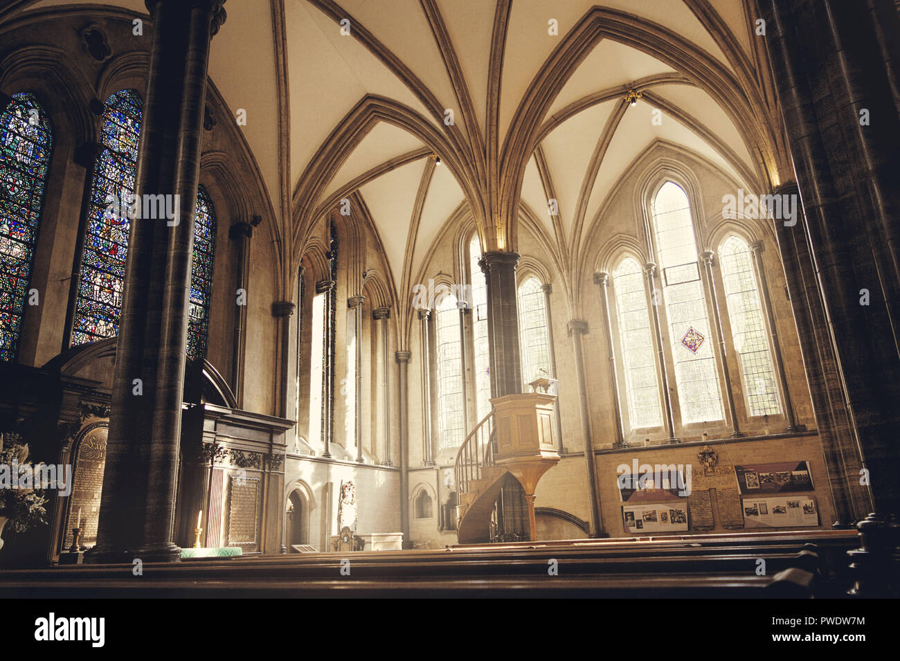 Pulpit and stained glass windows in Temple Church in London. - Stock Image