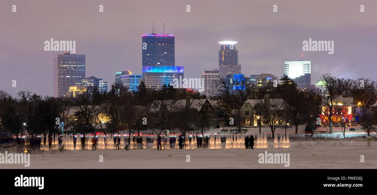 Minneapolis skyline with illuminated ice luminaries at the 2018 Luminary Loppet on Lake of the Isles in Minneapolis, Minnesota - Stock Image