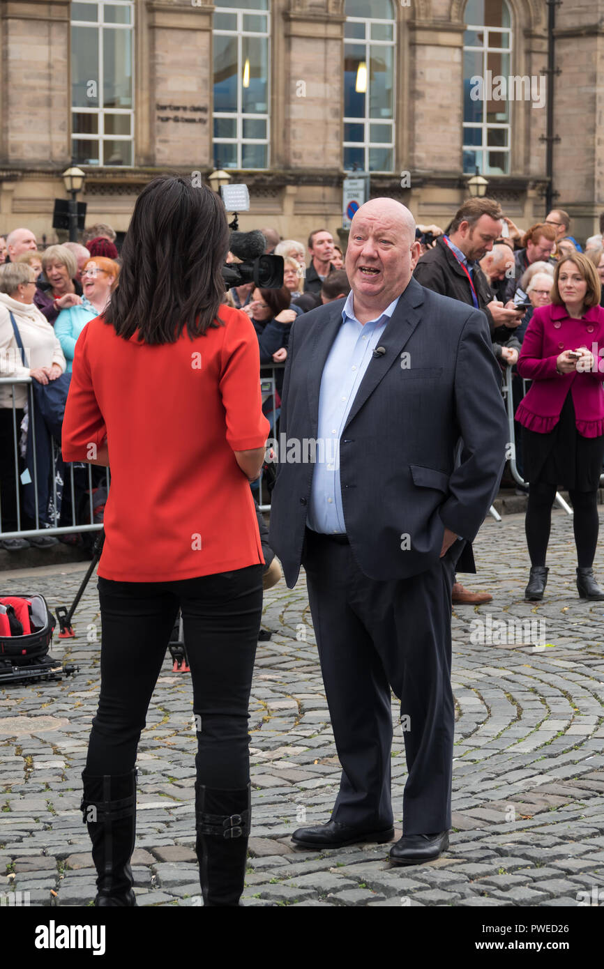 Joe Anderson OBE  the first directly elected mayor of Liverpool being interviewed by a news crew during The Giants weekend in Liverpool UK. - Stock Image