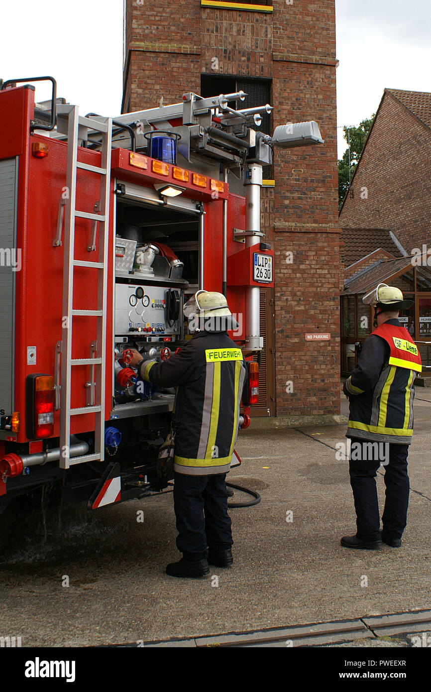 feuerwehr, fire appliance at incident - Stock Image